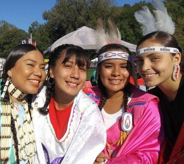 Ninijanisag youth in regalia at powwow